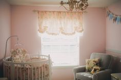 Pink French-inspired Nursery with a  Round Crib