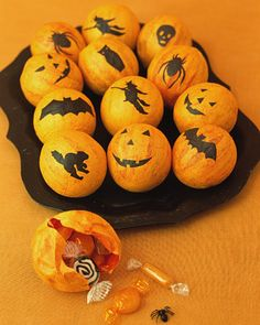 Treat Balls: Cover small balloons with one layer of orange tissue paper and then one layer of yellow. Cut out your own shapes, or download and print our silhouettes, then trace them onto black tissue paper; cut out each shape. Affix the silhouettes to spheres with diluted glue. When dry, enlarge knot holes (start cutting with utility knife, then finish with scissors). For party favors, fill balls with candy and tiny toys; paste a circle of orange tissue paper over the hole.