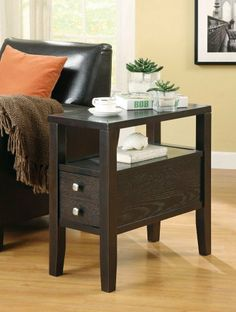 "SIDE TABLE,CAPPUCCINO 24''Lx12''Wx24''H by Coaster Home Furnishings. $109.99. Drawer and shelf. Casual Style. Offering both style and function, this practical chairside table is the perfect accent to your cozy arm chair. Organize books, magazines, and decor on this table for easy access. The dark cappuccino finish is accented with bright square drawer knobs for a modern touch. Dimensions:12"" W x 24"" H x 24"" D Some assembly may be required. Please see product details."