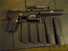 FN Herstal Five-seveN. Threaded and standard barrels, suppressor, 3 stock mags, 2 extended mags, StreamLight tactical flashlight. Weapons Guns, Guns And Ammo, Rifles, Fn Five Seven, Weapon Of Mass Destruction, By Any Means Necessary, Home Protection, Fire Powers, Military Guns