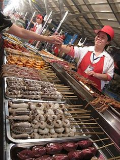 With Intrepid Travels' Real Food Adventures, try all the food at Donghuamen Night Market, Beijing China, including pigeon
