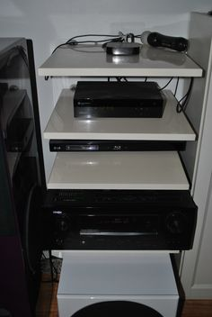 Hifi rack. Made of kitchen doors. Mount with hang for use in bathroom shelf.