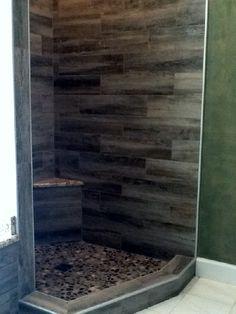 Dark wood shower walls. So unique!