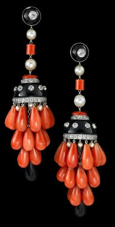 Art Deco style platinum, coral, onyx, pearl and diamond chandelier earrings   Petite Old European cut diamond in onyx frame with pearl and coral bead chain finishing in a diamond accented onyx dome with pear shaped coral chandelier fringe drops, post backing.