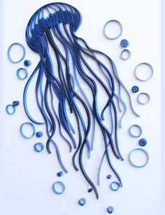 Here is your chance to own this unique master piece - first of its kind in the world. This wall art will impress your friends, family, and visitors and you -- as you dream If walls could talk, oooh they would say I want you more  The amazing world under water comes to life with this jellyfish crafted in hues of Indigo Blue. The quilled tentacles display the graceful movements of this gelatinous sea creature as it drifts along the ocean currents.  Details and Dimensions  Colors: Deep navy…