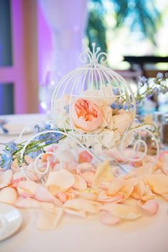 10 table decorations to make your fairytale wedding dreams come true cinderella coach reception table decor at a disneyland wedding junglespirit Image collections