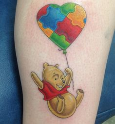 This adorable Winnie the Pooh tattoo supports autism awareness! Check out more autism awareness tattoo designs!