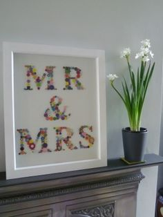 Wedding Collage. This would be a cute way to use buttons and to put in our home.