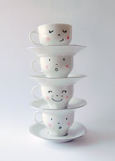 4 vintage hand painted smiling faces cups with pink cheeks: