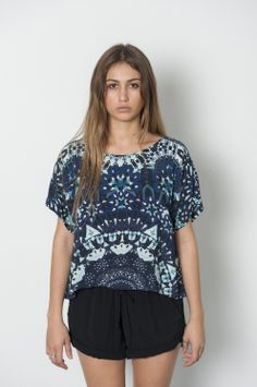 An+exclusiverue+stiic+cropped+half+mandalatop<br+/> this+top+is+printed+on+rayon+fujette<br+/> we+designed+this+mandala+to+every+last+detail+in+collaboration+with+textile+designer,+sharnee+thorpe<br+/> <br+/> get+to+know+sharnee:<br+/> <br+/> sharnee+thorpe+is+a+textile+designer+drawn+to+the+wild+elements+of+nature,mystical+tales+of+enchantment+and+a+nomadic+bohemian+lifestyle.+<br…