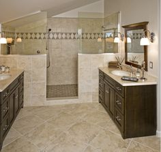 this master bathroom in ashburn, va features a large shower with