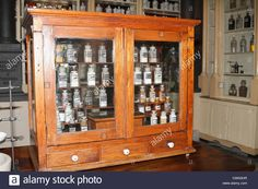 Download this stock image: Vintage medical pharmaceutical colorful chemical bottles on the shelf or table. Vintage old medical chemist's shop, chemistry - CWN3HR from Alamy's library of millions of high resolution stock photos, illustrations and vectors.