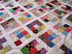 I call this one crazy for dots. 9-Patch quilt with white polka dot sashing.