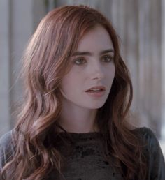 (strong eyebrows and brown eyeshadow surrounding the eye) Lily Collins as Clary Fray in City of Bones