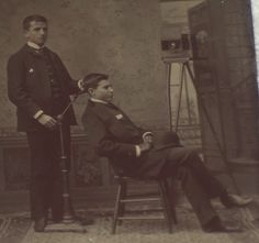 Photographer holding up the body of a deceased man before a post mort portrait.