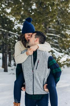 Gorgeous couple photo session in Michigan by Samantha Rice Photography. Loved this winter wonderland styled shoot and the beautiful green pine trees! For more portraits, engagement sessions, family sessions and styled shoots head to www.samantha-rice.com or @samantharicephotography on Instagram. Perfect snowy photo session!