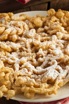 Funnel Cakes Recipe - Skillet fried batter  sprinkled with sifted powdered sugar