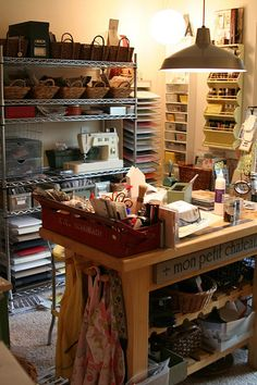 Note paper punch storage along back wall. Central work table too small for a cutting table. Like storage under table; should be counter height? Paper Punch Storage, Craft Room Storage, Craft Rooms, Art Studio Design, Sewing Rooms, Space Crafts, Interior Exterior, Decoration, Room Inspiration
