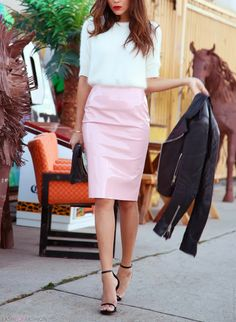 white furry sweater, pink leather skirt, and black extras