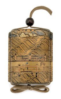 Black lacquer and gold inro of the Edo period (17th century).  Used in lieu of pockets, inro were carrying-cases closed by an ojime (sliding bead) and fastened to the obi by a netsuke.