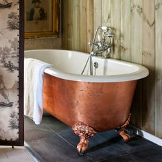 Copper free standing bath, wood panelled walls