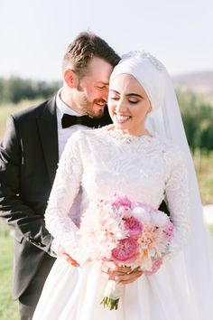 """From the editorial """"An Open-Air Ceremony in Cape Town Surrounded by Vineyards, Mountains and an Abundance of Peonies."""" Our favorite part? The couple's personal touches! They had evil eyes hanging from the tree in their photo booth, Zamzam water from Mecca, Saudi Arabia that holds healing qualities, and endless Turkish delights! 😍 Head to SMP to read on and don't forget to check out the full gallery by @punicafilms! #stylemepretty #weddingideas #brideandgroom #weddinginspiration Mecca, Saudi Arabia, Cape Town, Abundance, Photo Booth, Weddingideas, Peonies, Love Story, Wedding Styles"""