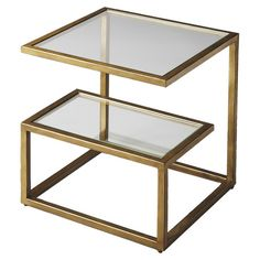 End table with 2 glass shelves and an antiqued gold frame.   Product: End tableConstruction Material: Cast aluminum an...