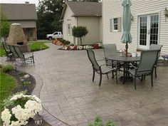 Great patio size with a soft curving edge.  Try Unilock Rivenstone with Brussels Block.