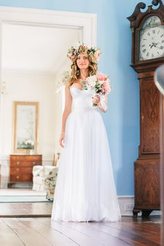 Polinas's mother brought the bride a traditional Ukrainian flower headpiece as well as her custom-designed wedding gown from Russia.