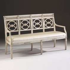 Neoclassic style carved beechwood settee with hand-rubbed antiqued white finish; Made in Italy