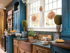 copper apron sink and gorgeous blue kitchen cupboards. Eclectic Kitchen Design by Indianapolis Kitchen and Bath Shannon Poecopper apron sink and gorgeous blue kitchen cupboards. Eclectic Kitchen Design by Indianapolis Kitchen and Bath Shannon Poe Distressed Kitchen Cabinets, Two Tone Kitchen Cabinets, Blue Cabinets, Farmhouse Kitchen Cabinets, Farmhouse Style Kitchen, Country Kitchen, New Kitchen, Kitchen Ideas, Farmhouse Sinks