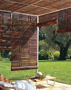 Roll-up Venetian blinds create adjustable shade on a sun-drenched patio.