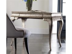 Simple glam exudes from the Palladium Writing Desk with graceful cabriole legs.