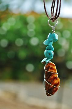 hawaii sea shell pendant, brown carafe flat sea shell piece, with turquoise colored beads, wire wrapped