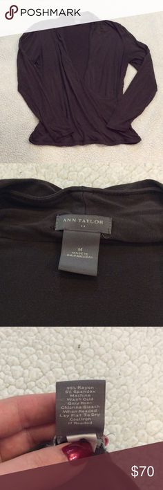 Ann taylor cross over wrap shirt Guc. Small hold on underside of the collar. No other major signs of wear. It's a mocha/charcoal color. It's sort of in between the two colors Ann Taylor Tops Blouses