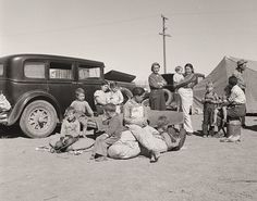 This photo was taken by, Dorothea Lange who took photos to document the lives of rural Americans living in terrible conditions. During this time, America was undergoing the worst drought. This is a black and white photo of four families from the Dust Bowl in Texas near Calipatria, California camping out.