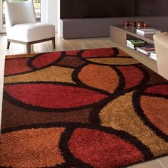 Modern Multi - Colored Shag Area Rug. Buying an area rug is a fantastic way to add color, warmth and comfort to any room or office space, as well as gain some of the benefits of carpet. This rug includes shades of brown, red, orange & beige. | eBay!