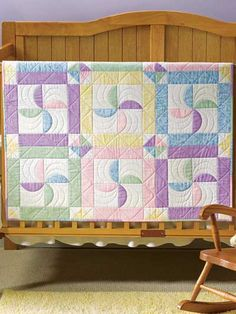 Pastel Pinwheels Quilt Pattern Download from e-PatternsCentral.com -- Curved applique pieces create pretty pinwheel shapes in this soft-hued baby quilt.
