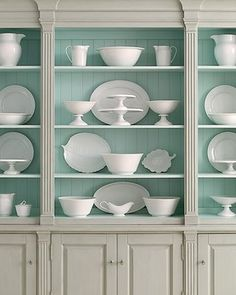 Turquoise back, white dishes (I like the unexpected turquoise in the back of the open shelved cabinet)