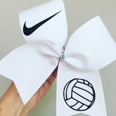 Big white volleyball bow with Nike swoosh. Stiff. Ponytail holder attached! Free shipping!