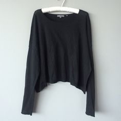 Vince black long sleeve top This is a super stylish long sleeve top made by Vince. The torso is wide and gives it a very cool drapey effect. This has been preowned but shows no major signs of wear. This is a size Small. Price is firm. Vince Tops