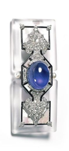 Cartier brooch, 1924. Cabochon cut sapphire (weighing approximately 57.60 carats), diamonds, pearls, rock crystal, enamel, platinum and gold.