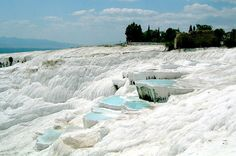 "Pamukkale Small Group Day Tour from Kusadasi or Selcuk  Enjoy this day trip to Pamukkale which is the center of natural thermal spring waters with healing properties. Due to the chemical properties in the water, pure white colored travertines and stepped water terraces have been created on the mountain slope. It is for its resemblance to cotton piles that it is called ""Cotton Castle"" in Turkish. Visit the travertines and the Ancient City of Hierapolis which has the biggest Ne..."