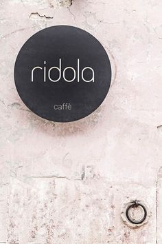 Based in Materia, Italy, Manca Studio have designed Caffè Ridola that highlights a selection of cut out motifs. Black panels with floral motifs contrast with brick walls and wire furniture. Restaurant Branding, Cafe Restaurant, Italian Restaurant Logos, Cafe Branding, Wall Logo, Logo Sign, Signage Design, Cafe Design, Studio Design