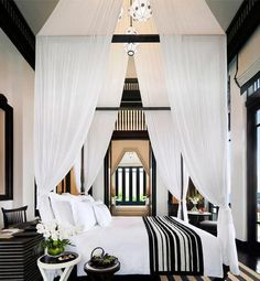 Black and white bedroom with a canopy