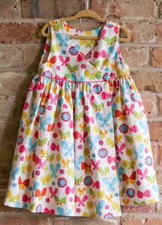 Super cute Children's Corner Mary De sundress made with fabrics from Lola Pink Fabrics