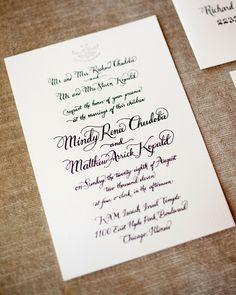 Lady Fingers Letterpress created the calligraphed letterpress invitation suite. The subtle icon at the top of the card mimicked the bride's lace gown.