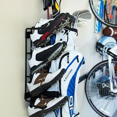 Lift everything off of the floor and out of the way with a wall-mount rack. This little organizer gathers two sets of golf clubs and four pairs of shoes in one accessible location./