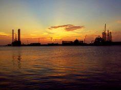 Sun is setting on Galveston Harbor