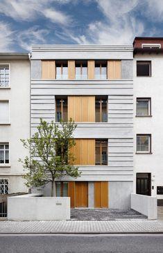 Pünktchen / Güth & Braun Architekten + DYNAMO Studio // not always a fan of symmetrical projects but the warm materials here make it unimposing